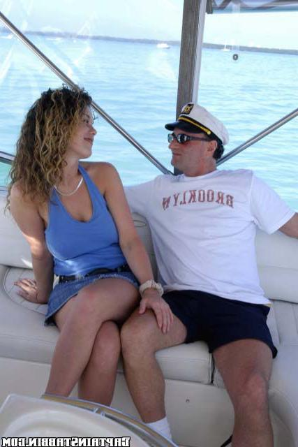 Curly slut agreed to have sex with two strangers on yacht 6 photo