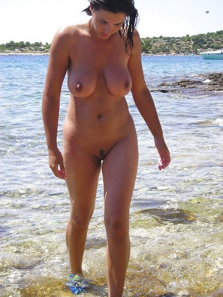 Attractive girls sunbathing on the beach without underwear 5 photo