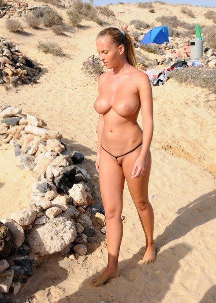 Attractive girls sunbathing on the beach without underwear 20 photo