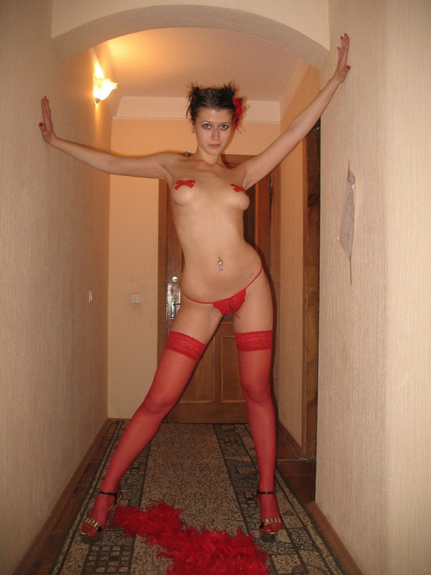 Slut in nurse costume and red stockings  makes a blowjob to her man 2 photo