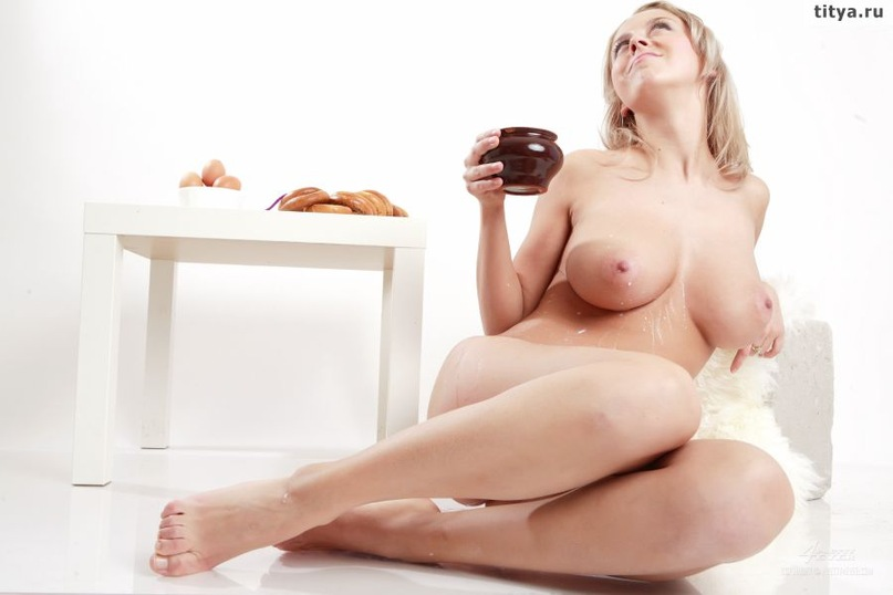 Busty blonde pours on her body white milk 32 photo