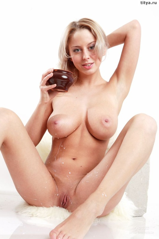 Busty blonde pours on her body white milk 26 photo