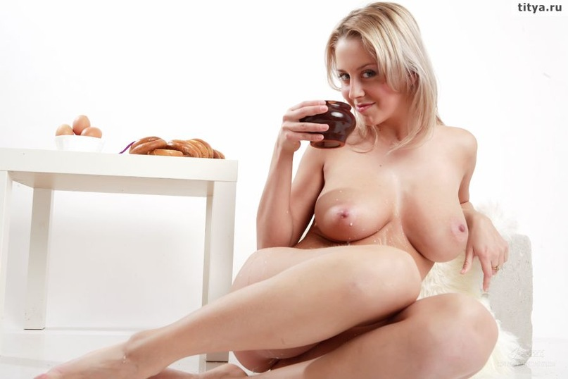 Busty blonde pours on her body white milk 31 photo
