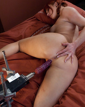 Ginger slut testing a new machine for sex