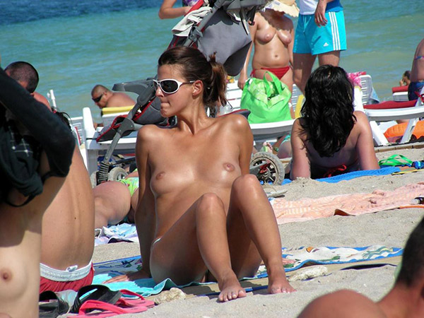 Spying on the beach for the topless women 12 photo