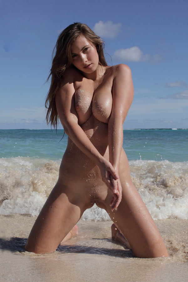 Pretty model with big tits at the beach 10 photo
