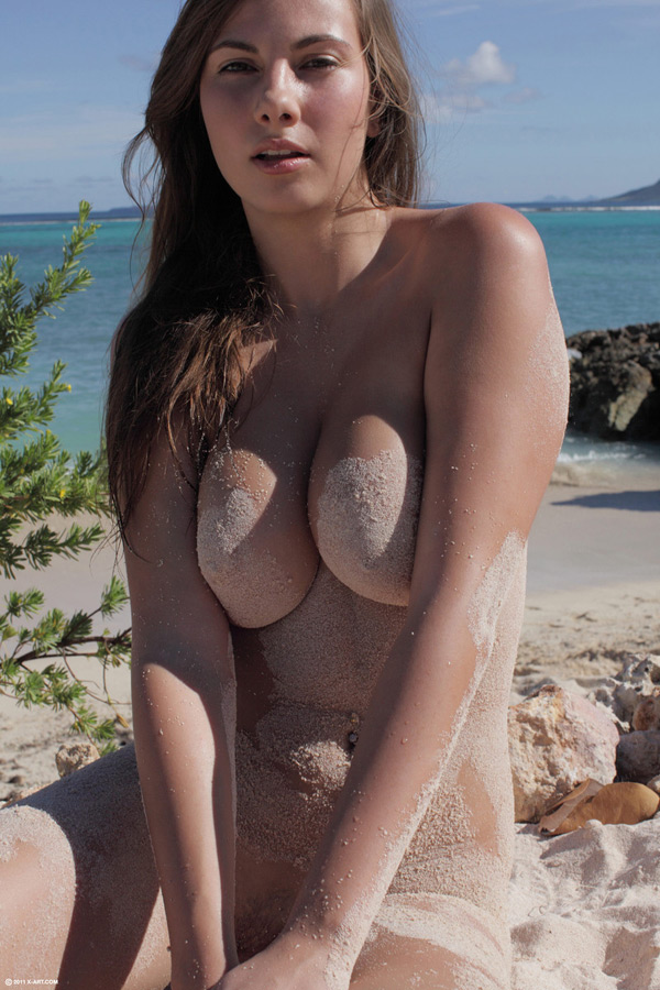 Pretty model with big tits at the beach 12 photo