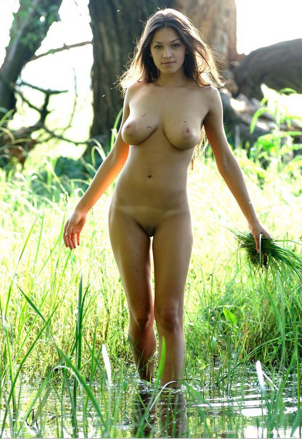 Model with big breasts naked on a swamp 4 photo