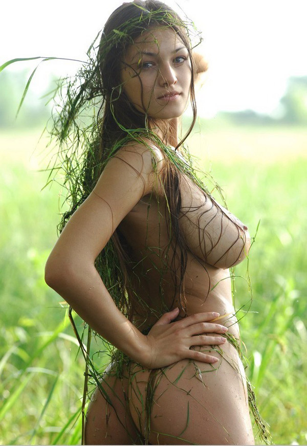 Model with big breasts naked on a swamp 7 photo