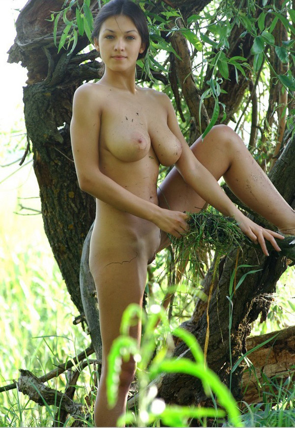 Model with big breasts naked on a swamp 8 photo