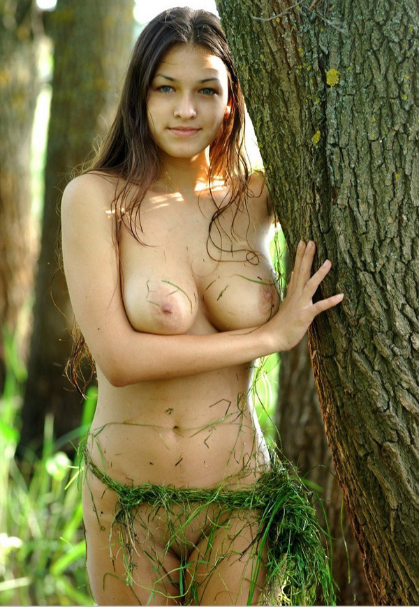 Model with big breasts naked on a swamp 9 photo