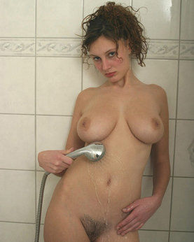 Beautiful bitch with hairy pubis showers