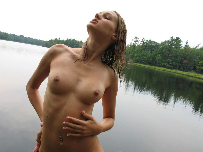 Russian beauty in thoroughly wet clothes on the lake 7 photo