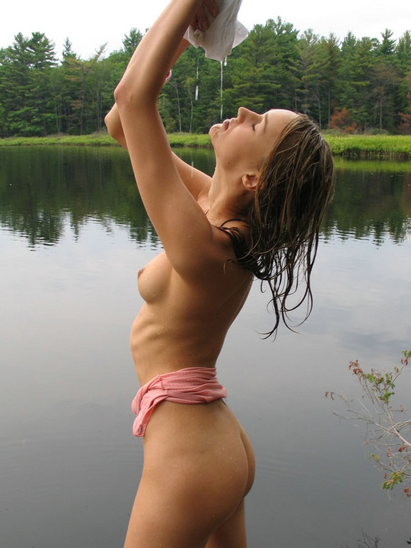 Russian beauty in thoroughly wet clothes on the lake 6 photo