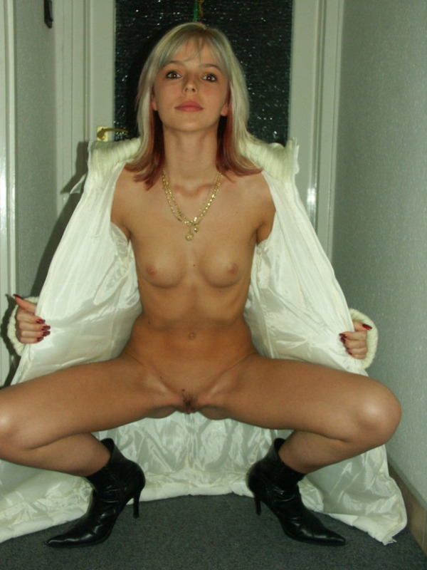 Slim slut in fur coat pulls her pussy 4 photo