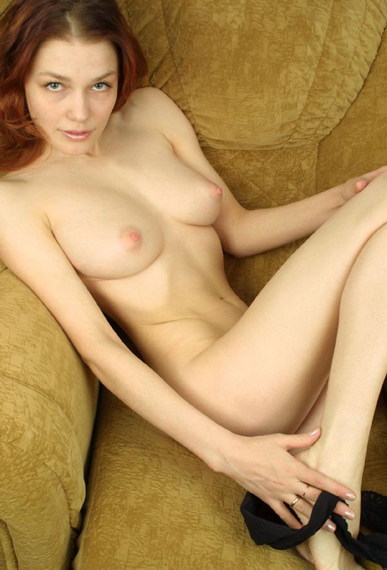 Pretty red-haired girl with delicate pink nipples 2 photo