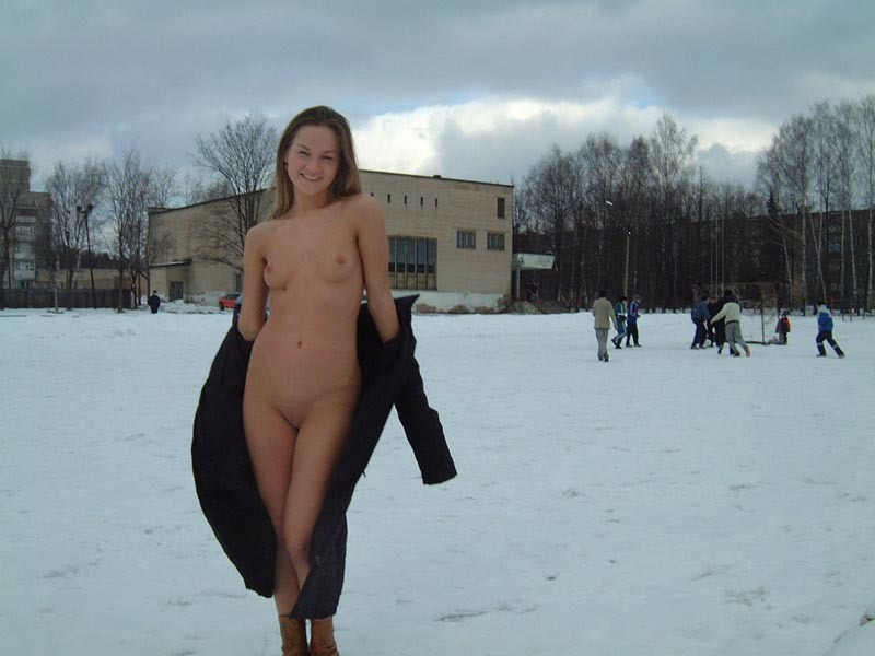 Football cheerleader stripped at the playground in the winter 9 photo