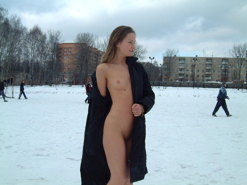 Football cheerleader stripped at the playground in the winter 7 photo