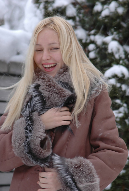 Beautiful blonde shows her naked body in the winter yard 1 photo