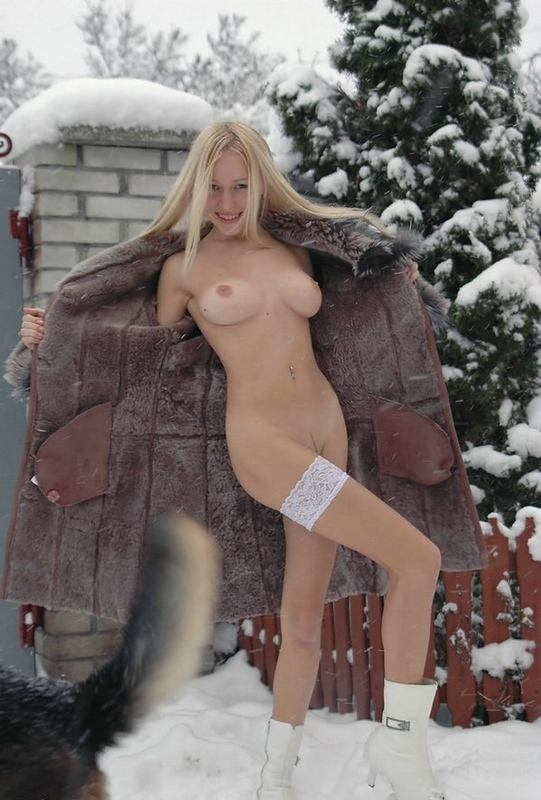 Beautiful blonde shows her naked body in the winter yard 9 photo