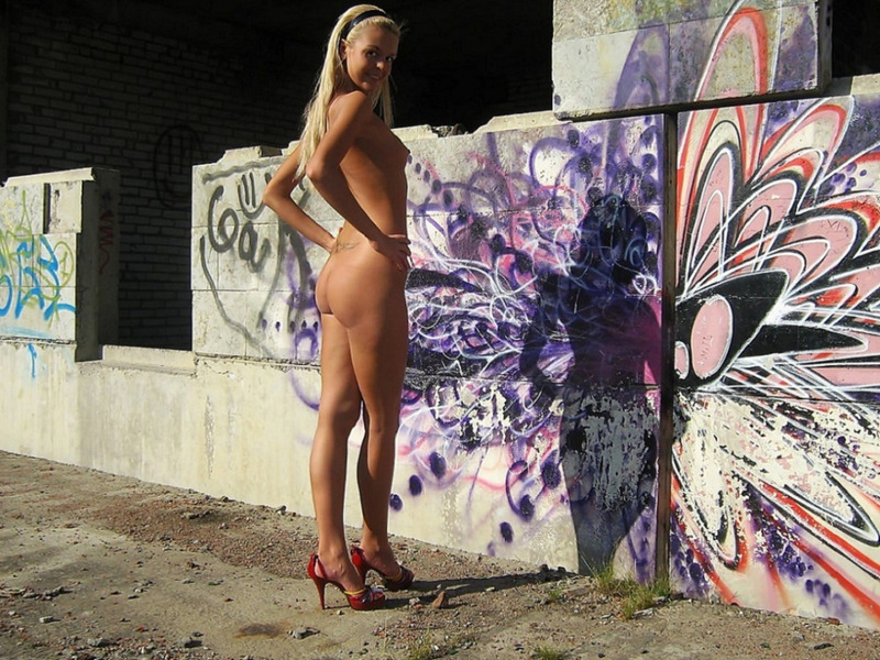 Pretty blonde with small tits posing naked on a deserted building site 2 photo