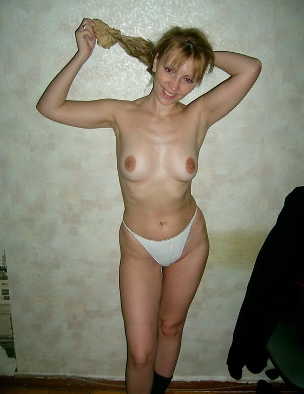 Russian mom stripped by the wall 3 photo