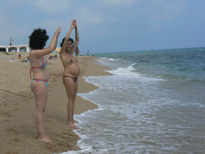 Pregnant with girlfriend relaxing topless on the beach 14 photo