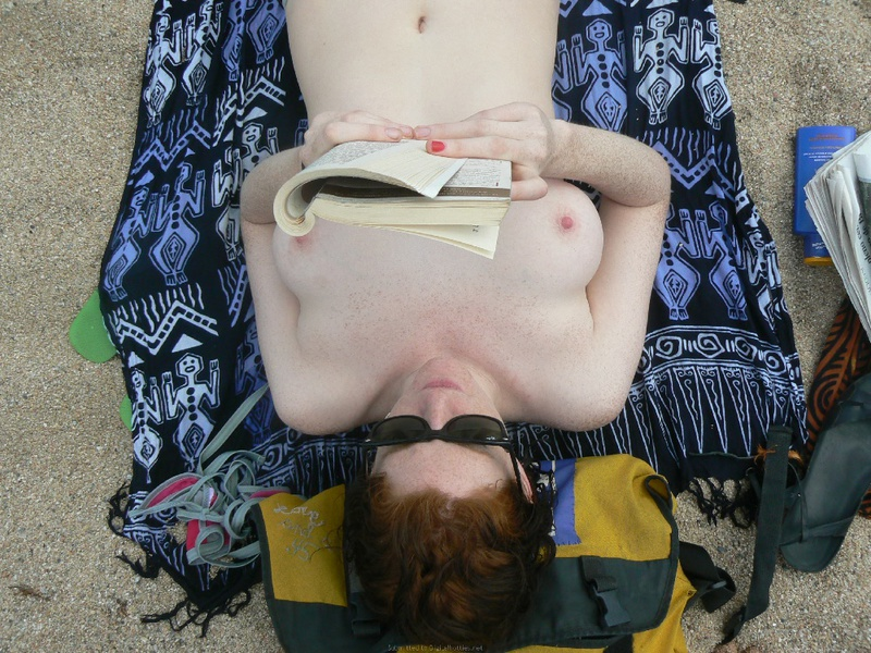 Pregnant with girlfriend relaxing topless on the beach 16 photo