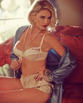 Elegant Playboy star with a cool breast in retro lingerie