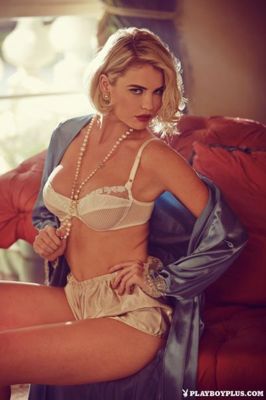 Elegant Playboy star with a cool breast in retro lingerie 4 photo