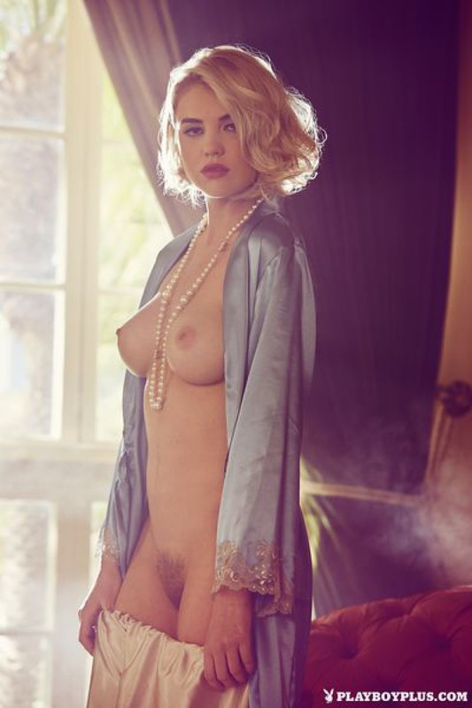 Elegant Playboy star with a cool breast in retro lingerie 11 photo