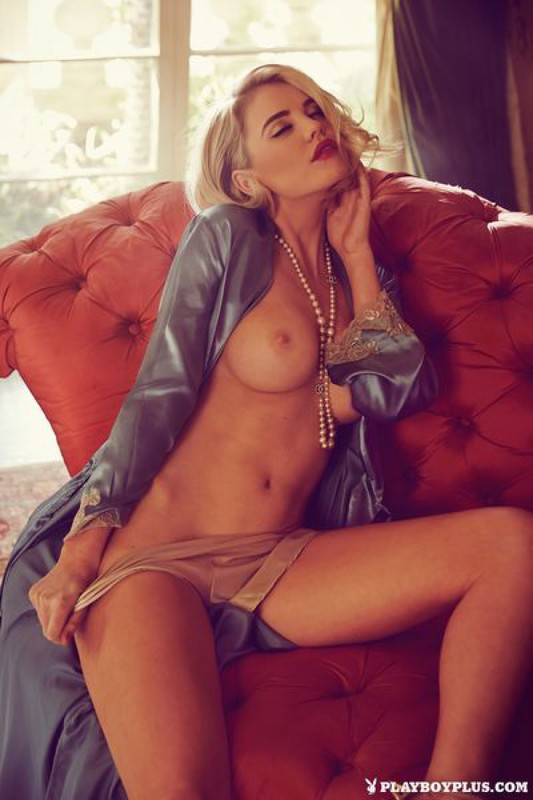 Elegant Playboy star with a cool breast in retro lingerie 6 photo