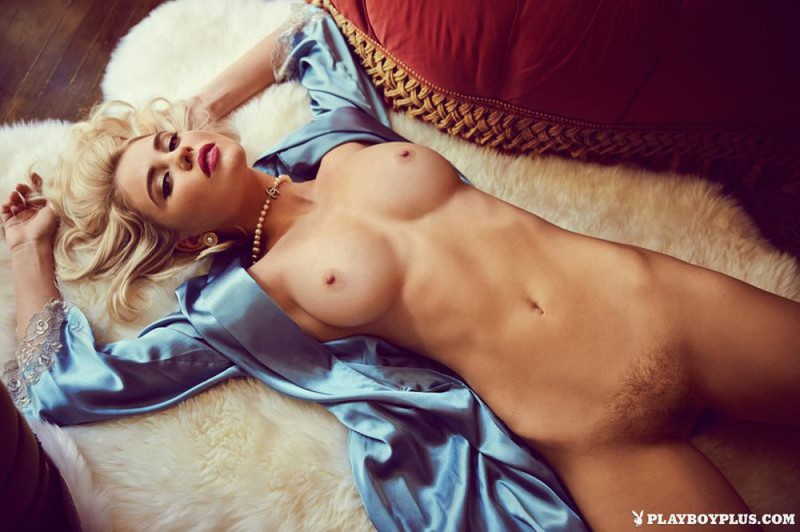 Elegant Playboy star with a cool breast in retro lingerie 13 photo