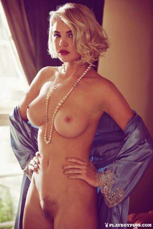 Elegant Playboy star with a cool breast in retro lingerie 15 photo