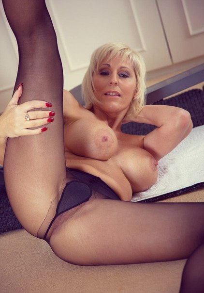 Mature naked ladies spreading legs photo 15 photo