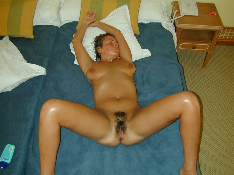 Tanned titted lady shows hairy pussy in the hotel room 7 photo