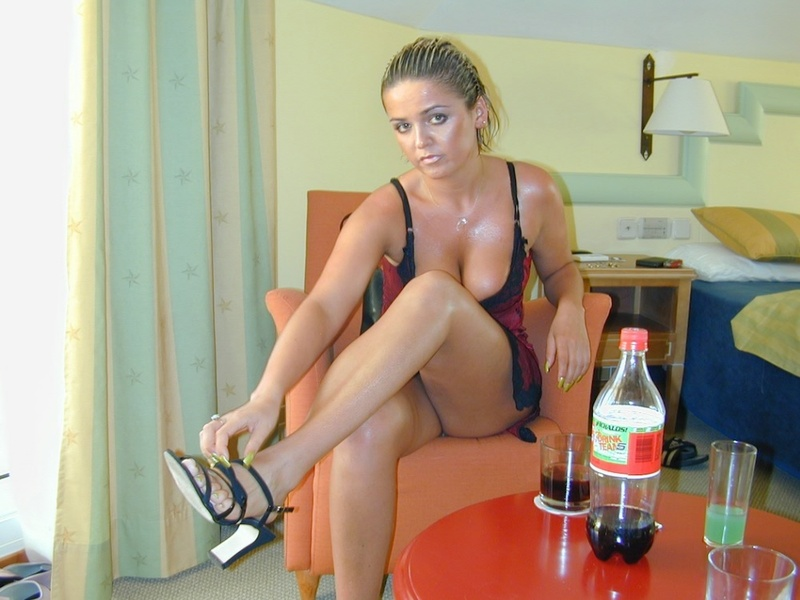 Tanned titted lady shows hairy pussy in the hotel room 3 photo
