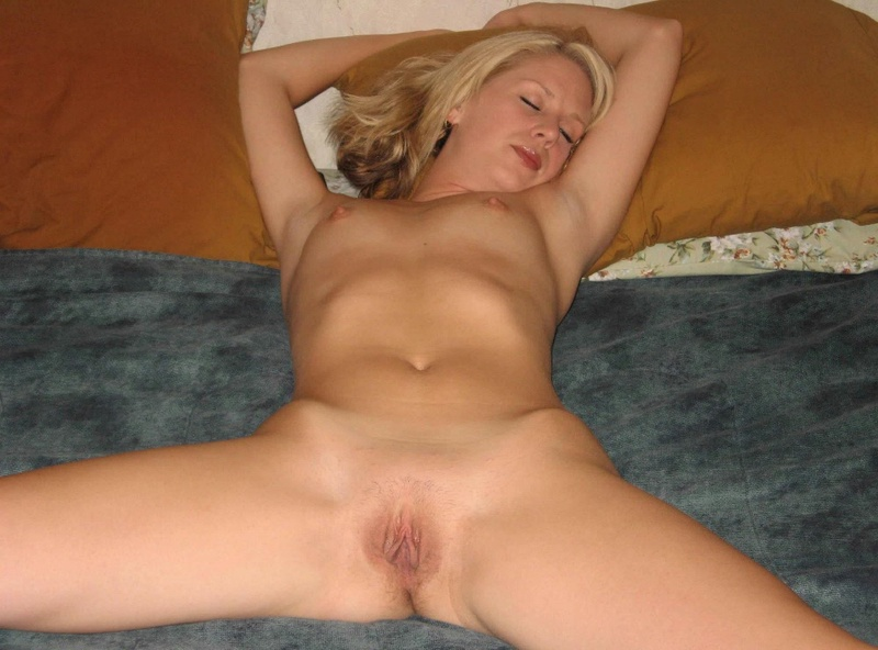 Blonde is widely spread her legs and showed pussy 11 photo
