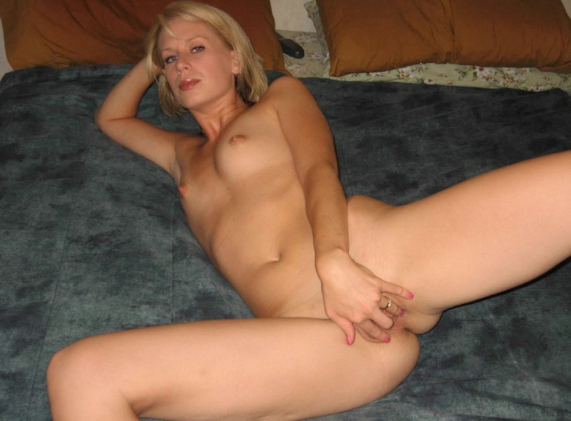 Blonde is widely spread her legs and showed pussy 6 photo
