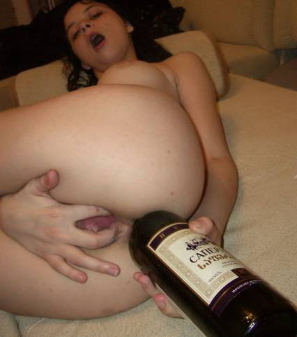 Slut tearing her tender holes with bottle of wine 5 photo