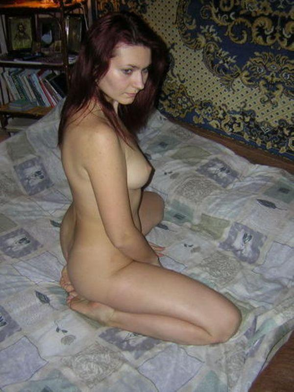 Red-haired beauty with a great desire whirls naked on the bed 3 photo