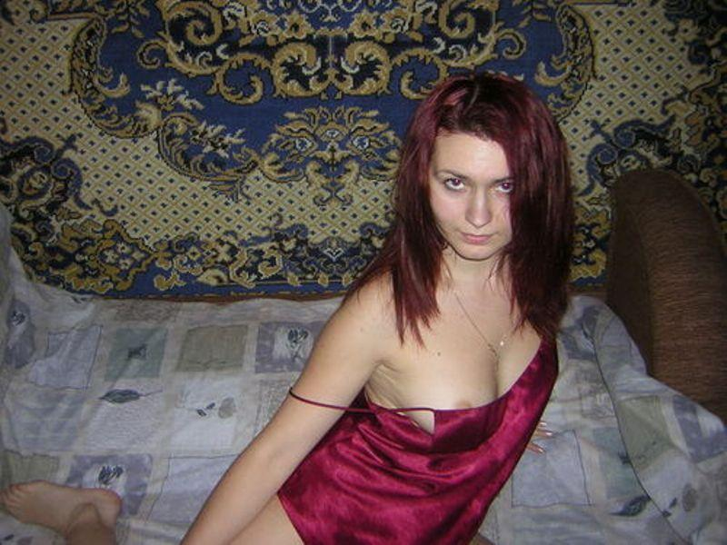 Red-haired beauty with a great desire whirls naked on the bed 2 photo