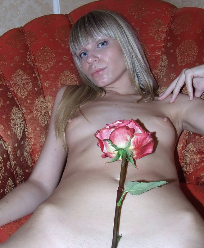 Cute young blonde leans beautiful rose to her naked pussy 15 photo