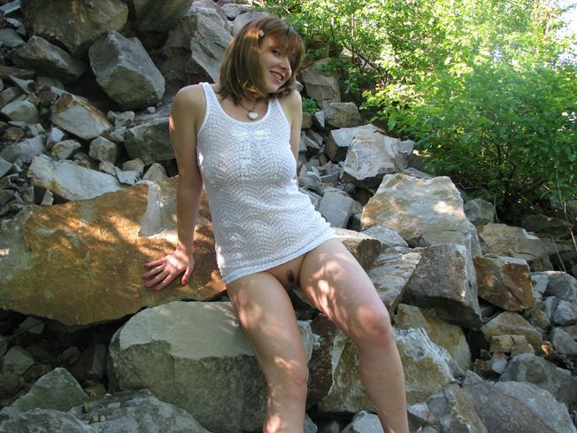 Cute redhead lady shows pussy under skirt at the lake 10 photo