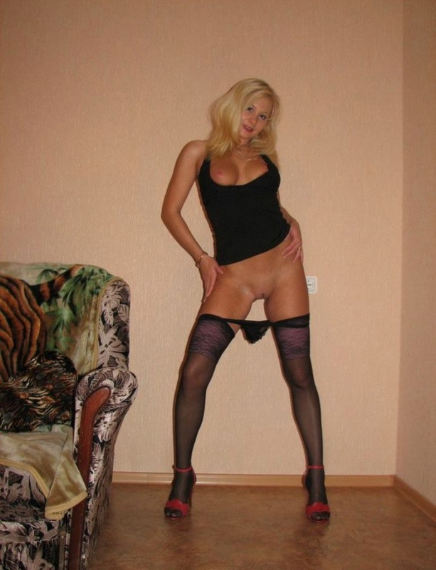 Playful bitch with narrow pussy spreads long legs on a sofa 2 photo