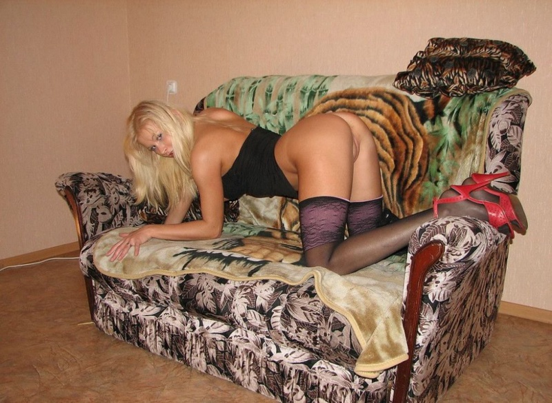 Playful bitch with narrow pussy spreads long legs on a sofa 4 photo