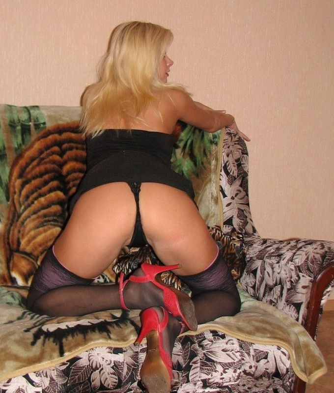 Playful bitch with narrow pussy spreads long legs on a sofa 1 photo