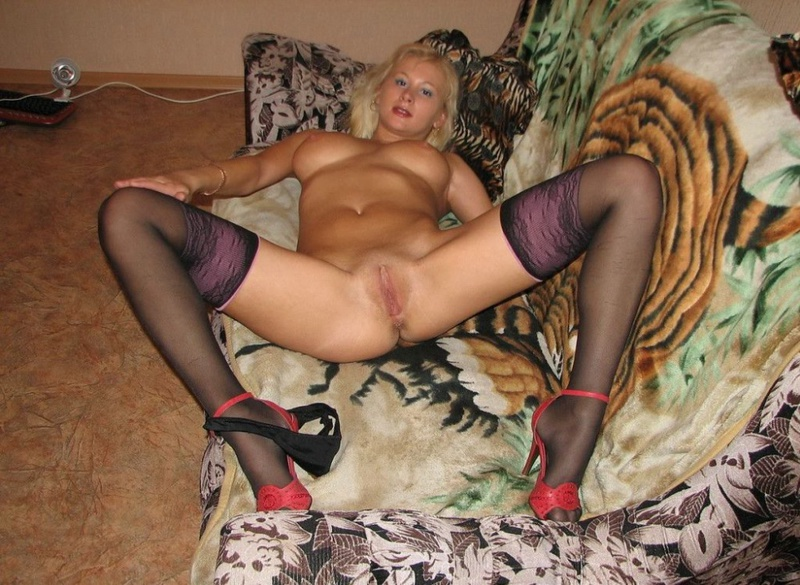 Playful bitch with narrow pussy spreads long legs on a sofa 5 photo