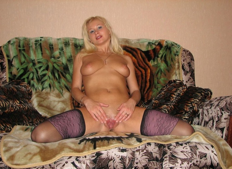 Playful bitch with narrow pussy spreads long legs on a sofa 12 photo