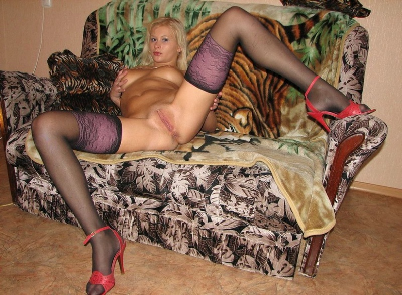 Playful bitch with narrow pussy spreads long legs on a sofa 7 photo